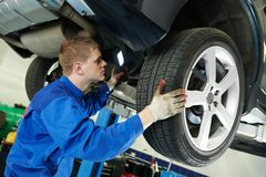 Auto mechanic at car brake shoes eximining Stock Photo