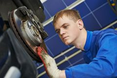 Auto mechanic at car brake shoes eximining Stock Photos