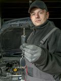Auto mechanic with car key Stock Photo