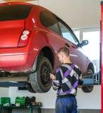 Auto mechanic. At car suspension repair work royalty free stock image