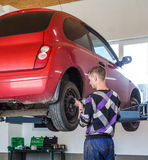 Auto mechanic. At car suspension repair work royalty free stock photography