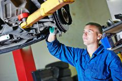 Auto mechanic at car suspension repairing Royalty Free Stock Image