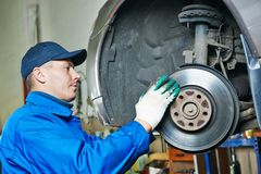 Auto mechanic at car suspension repairing Royalty Free Stock Photo
