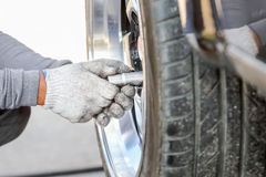 Auto mechanic changing racing car wheel Royalty Free Stock Images