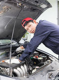 Auto mechanic check engine car Royalty Free Stock Photo