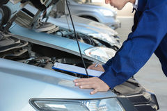 Auto mechanic checking car engine Royalty Free Stock Photography
