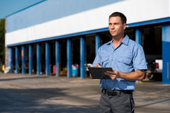 Auto Mechanic. With Clipboard at Work Royalty Free Stock Photography