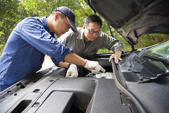 Auto mechanic fixes a car Royalty Free Stock Image
