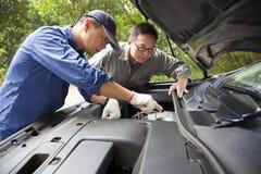 Auto mechanic fixes a car royalty free stock image