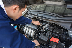Auto mechanic fixing car. Auto mechanic (or technician) fixing car engine Stock Photo