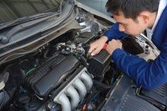 Auto mechanic fixing car. Auto mechanic (or technician) fixing car engine stock images