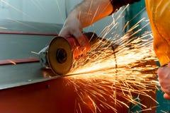 Auto mechanic grinding metal Stock Image