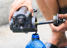 Auto mechanic hand holding motor oil Stock Image