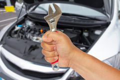 Auto mechanic hand with wrench Royalty Free Stock Photography