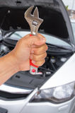 Auto mechanic hand with wrench Stock Photo