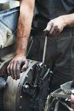 Auto mechanic hands at car repair work Royalty Free Stock Photo