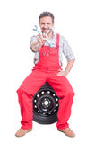 Auto mechanic holding crossed spanners or wrenches Royalty Free Stock Photo