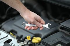 Auto mechanic with iron spanners in closeup Stock Image