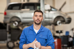 Auto mechanic man or smith at car workshop Royalty Free Stock Image