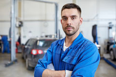 Auto mechanic man or smith at car workshop Stock Images