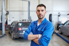 Auto mechanic man or smith at car workshop Royalty Free Stock Photos