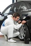 Auto mechanic painting car element Stock Photo