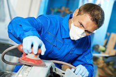 Auto mechanic polishing car Royalty Free Stock Photos
