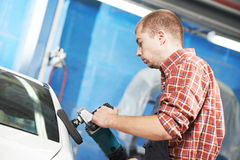Auto mechanic polishing car Royalty Free Stock Images