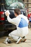 Auto mechanic polishing car Royalty Free Stock Image