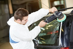 Auto mechanic polishing car Stock Photography