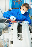 Auto mechanic polishing car Stock Image