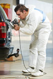 Auto mechanic polishing car Royalty Free Stock Photos