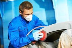 Auto mechanic polishing car Stock Photos