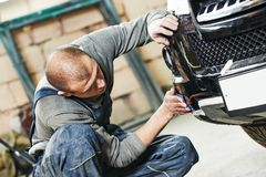 Auto mechanic polishing car Stock Images