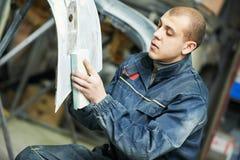 Auto mechanic polishing car Stock Images