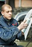 Auto mechanic polishing car Royalty Free Stock Images