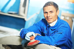 Auto mechanic with polishing sander Stock Image