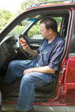 Auto Mechanic Reading A Fault Code Scanner Royalty Free Stock Photography
