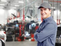 Auto mechanic. Auto repair service. Handsome smiling mechanic