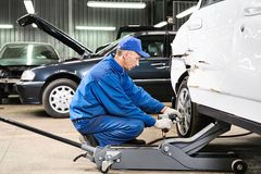 Auto mechanic at repair work Royalty Free Stock Photography