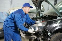 Auto mechanic at repair work Stock Photos