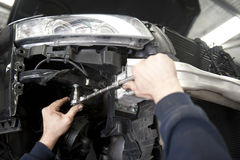 Auto mechanic repairing car Royalty Free Stock Images