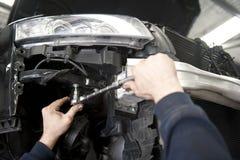 Auto mechanic repairing car Royalty Free Stock Images