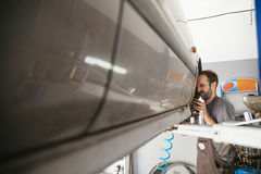 Auto Mechanic Repairing Car Stock Photography