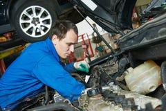 Auto mechanic repairman at work Royalty Free Stock Photo
