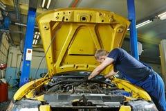 Auto mechanic repairman at work Stock Images