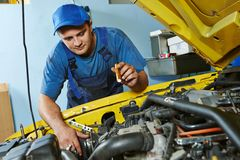 Auto mechanic repairman at work Royalty Free Stock Image
