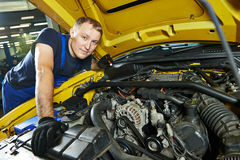 Auto mechanic repairman at work Royalty Free Stock Images