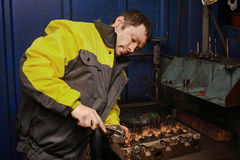 Auto mechanic repairs engine forklift Stock Image
