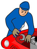 Auto mechanic repairs a motor Royalty Free Stock Photo